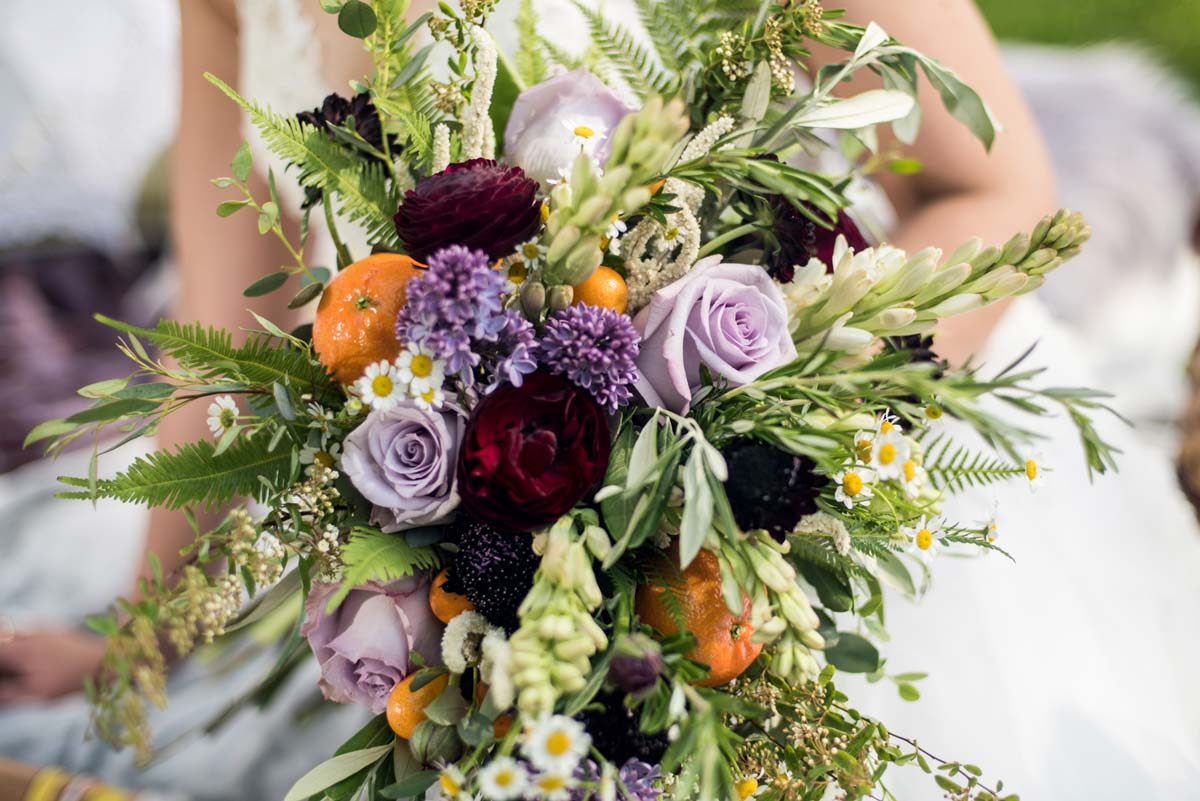Botanical style bouquet with pops of deep colors