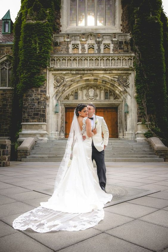 Bride and Groom Posing Outside A Cathedral