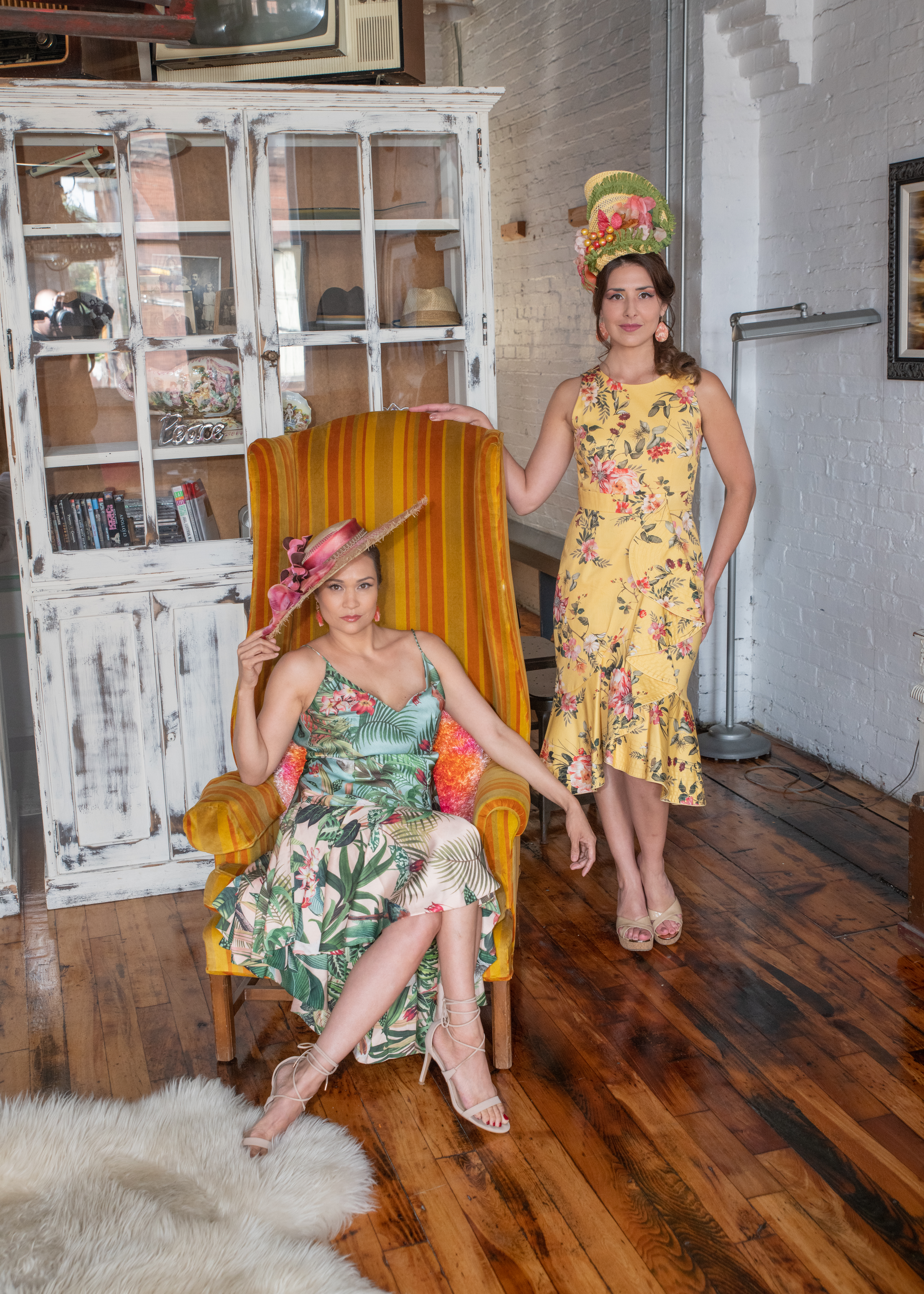 Models Lani Dee & Michelle Senko clad in modern dresses with a vintage tropical vibe