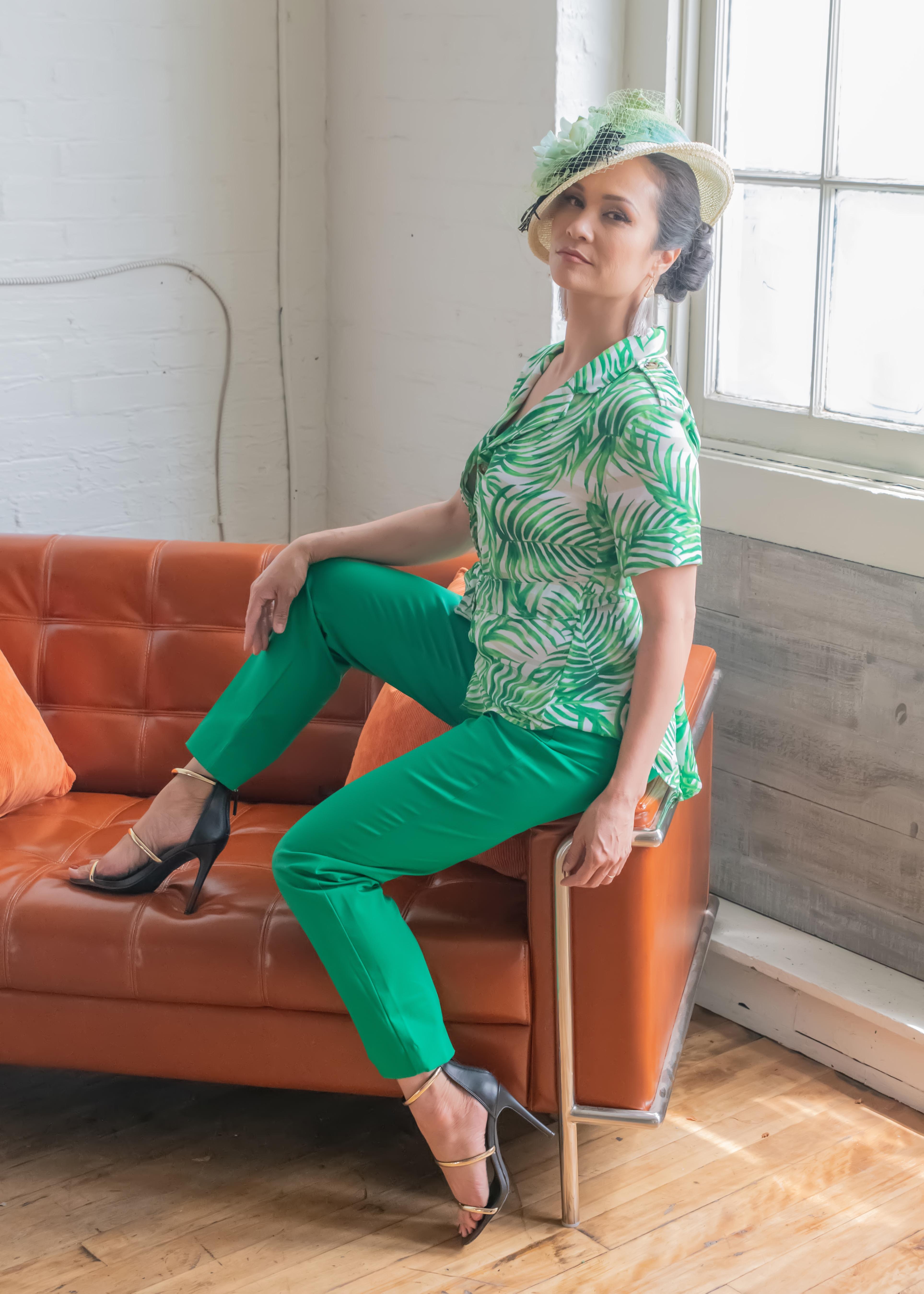 Palm Paradise Model Lani Dee sporting a chic vivid green ensemble and custom hat