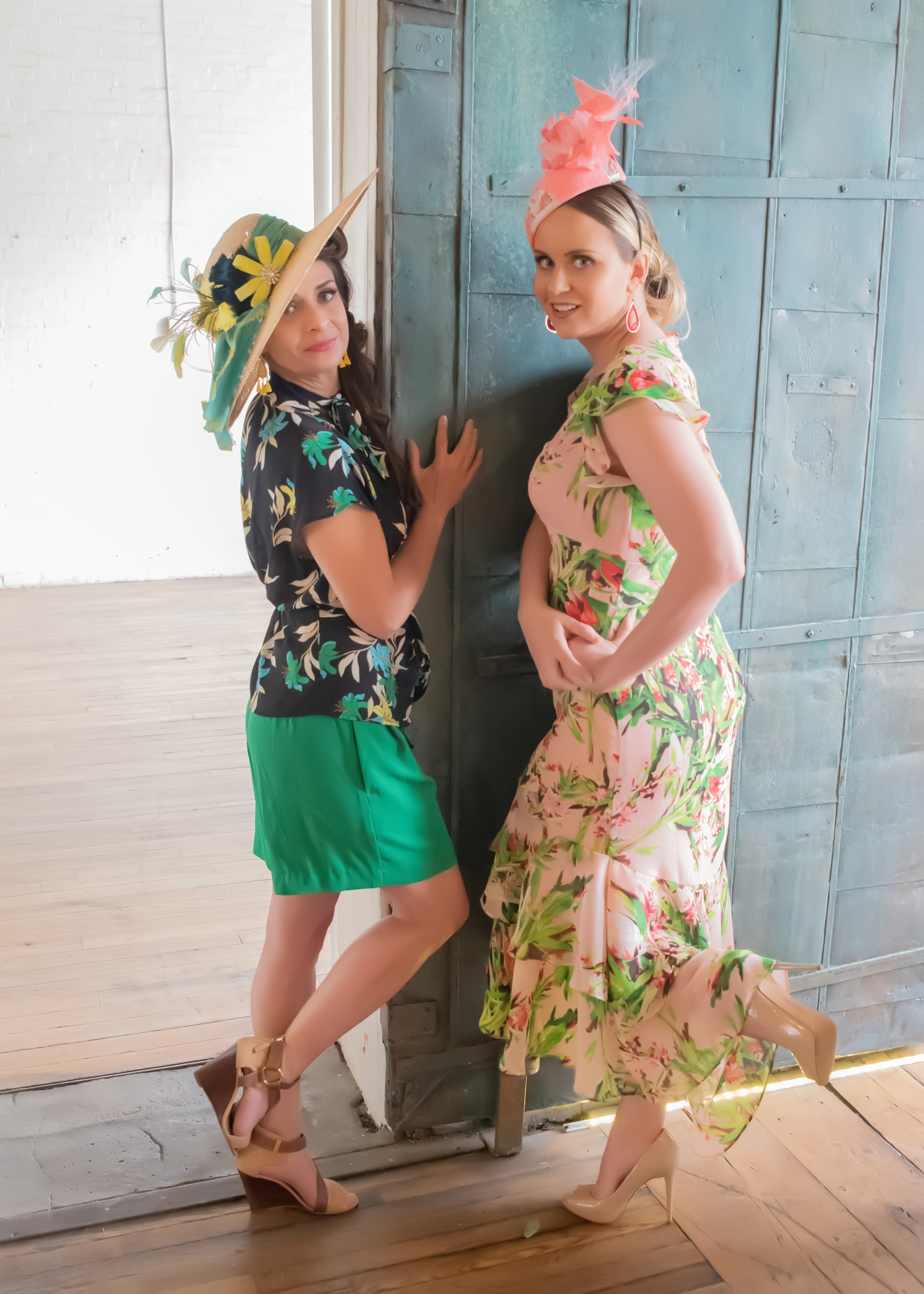 Palm Paradise Models Alice Beckett-Rumberger and Sindel Taylor posing near a repurposed garage door painted in a fun blue hue.