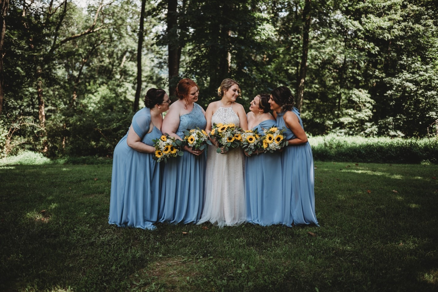 The Maids looking pretty in their steel blue dresses which looked gorgeous against the sunflower bouquets