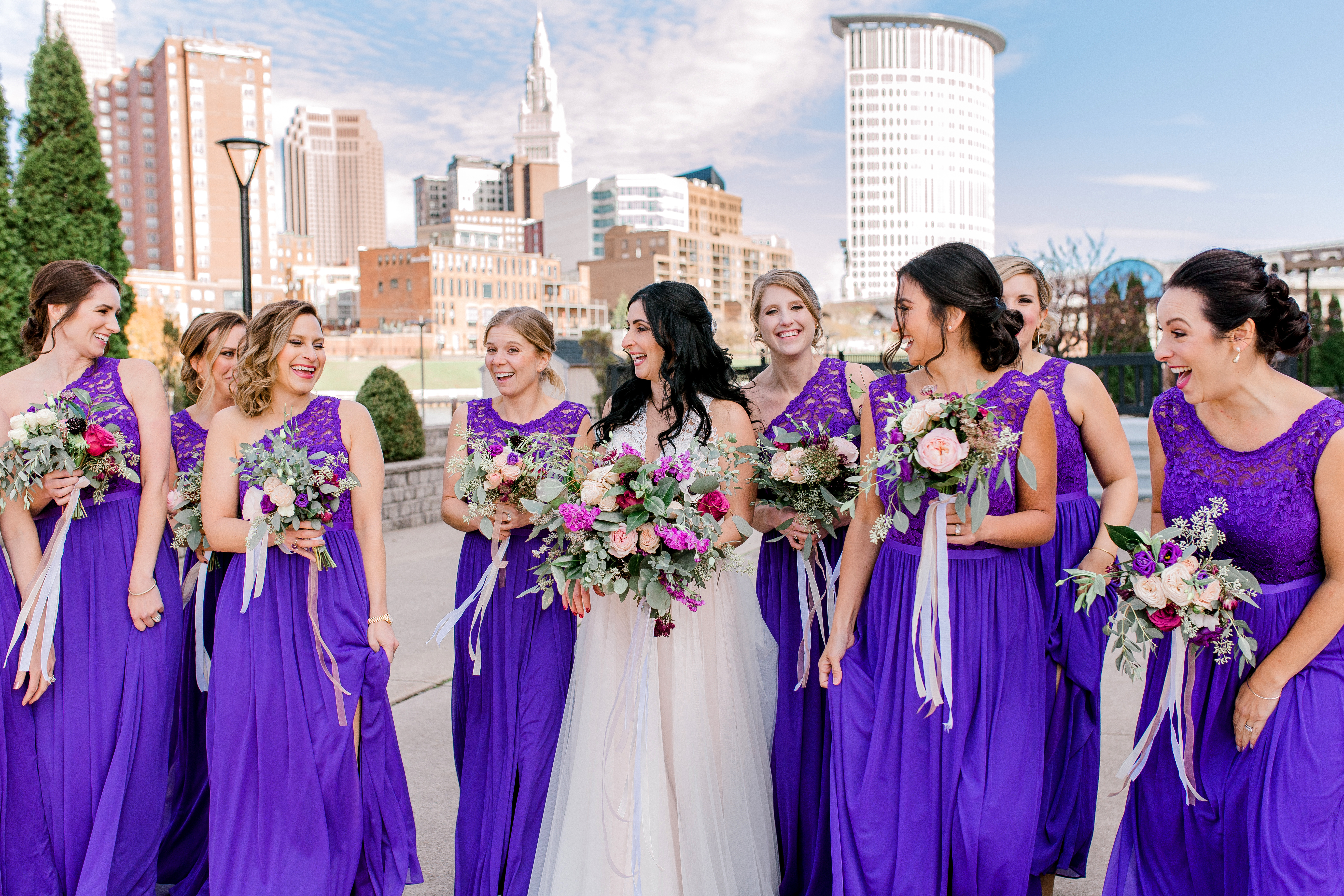 The bride accompanied by her gorgeous gals along the river in Cleveland! Photo by: Marissa Camino Photography