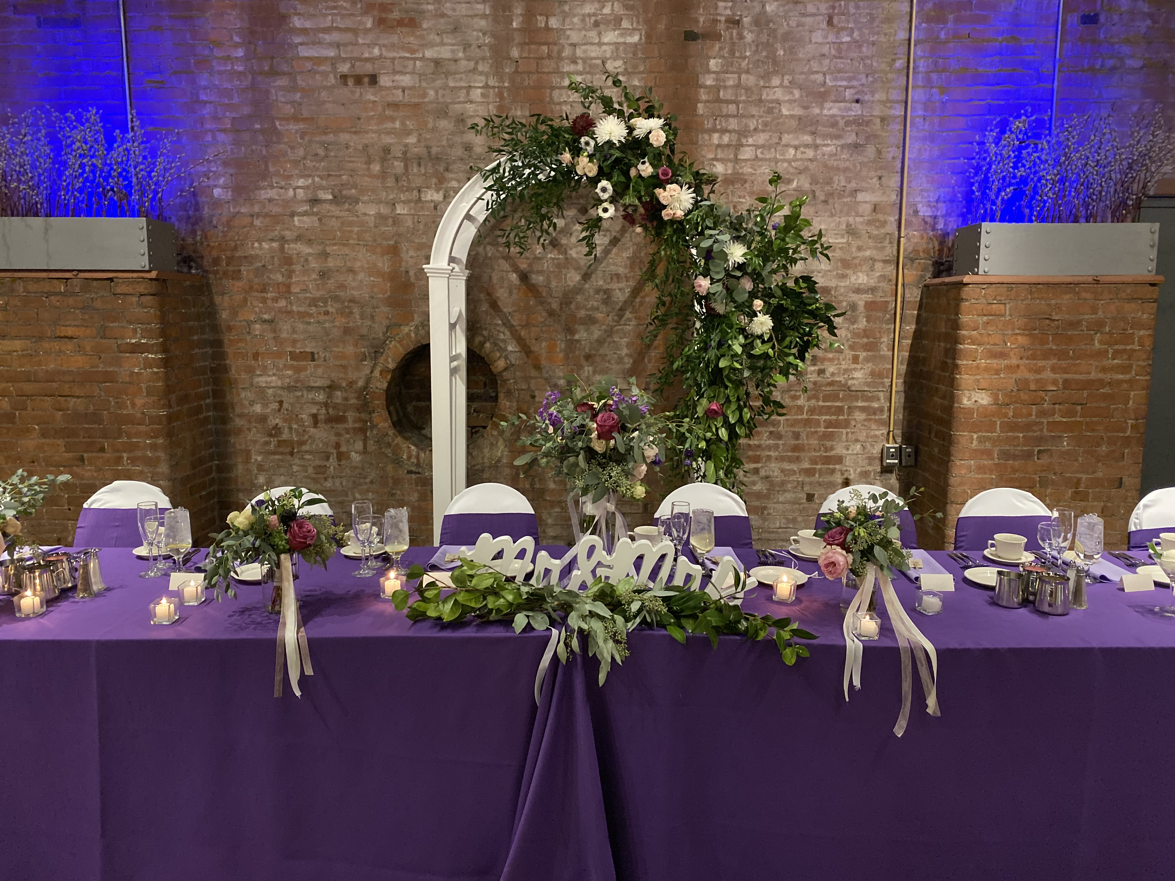 Custom floral arch by Avalon Gardens