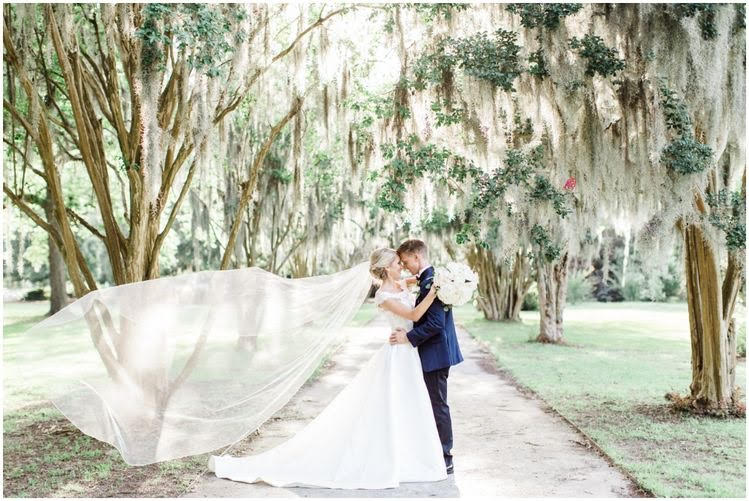 Breathtaking bridal shot on the grounds of The Cedar Room in Charleston, SC   Photo by Bow Tie Collaborative